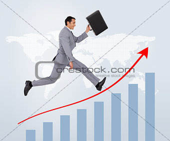 Smiling businessman running against a background