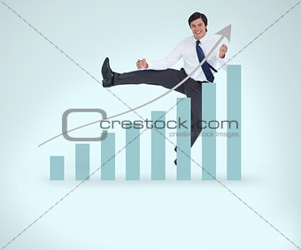 Smiling businessman jumping over the graphical presentation