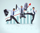 Businessmen jumping against a graphical presentation
