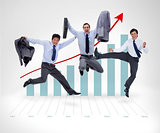 Businessmen jumping before graphical presentation