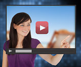 Woman pointing on touch screen with video