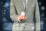 Businessmans finger activating futuristic touchscreen