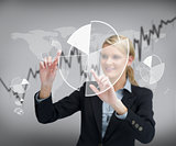 Businesswoman using graphical presentation on touch screen