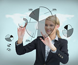 Businesswoman touching screen with graphs