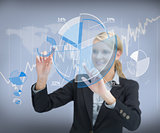 Businesswoman working with graphs on touch screen