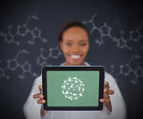 Smiling woman showing us sphere on tablet