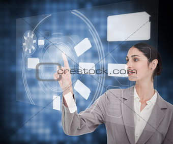 Businesswomans finger pointing touch screen
