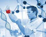 Scientist examining a beaker
