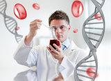 Serious chemist examining a beaker