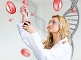 Female scientist examining blood