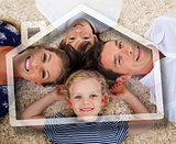 Smiling young family lying with heads together
