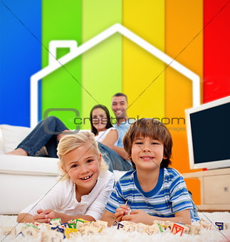 Two children lying on a carpet in front of house illustration and energy efficiency lines