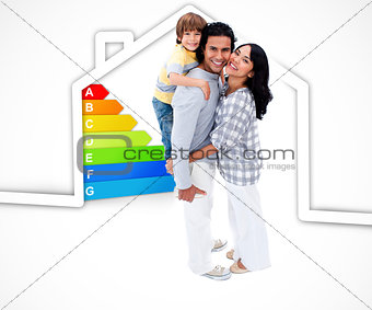 Smiling family standing with a house illustration with energy rating graphic