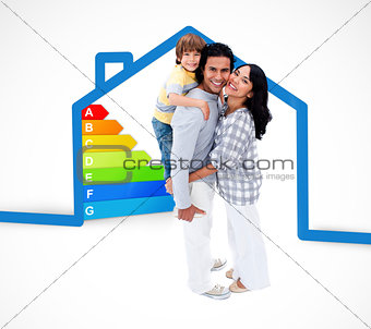 Smiling family standing with a blue house illustration with energy rating graphic