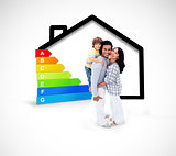 Smiling family standing with a black house illustration with energy rating