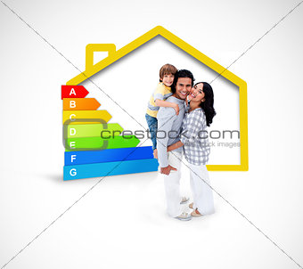 Smiling family standing with a yellow house illustration with energy rating