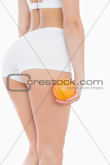 Woman in shorts with orange