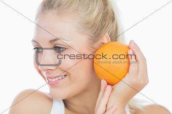 Pretty woman with fresh orange