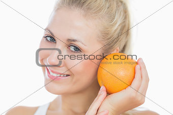 Happy woman with fresh orange