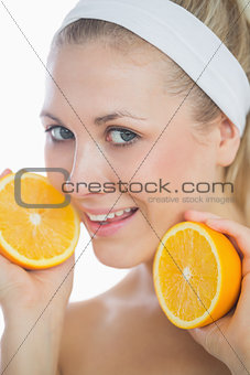 Beautiful woman holding orange slices