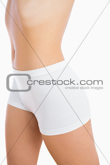 Female slender body in shorts