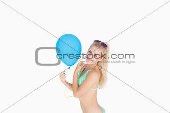 Portrait of woman holding balloon