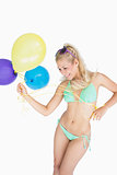 Cheerful woman holding balloons