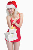 Woman opening christmas present