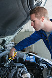 Mechanic working on car engine
