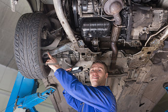 Auto mechanic examining car tire