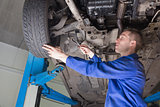 Male mechanic repairing car