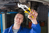 Man repairing car with pliers