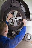 Mechanic fixing car wheel