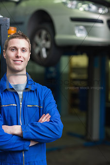 Smart car mechanic smiling
