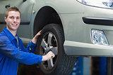 Auto mechanic changing car tire