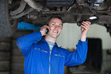 Car Mechanic using cell phone