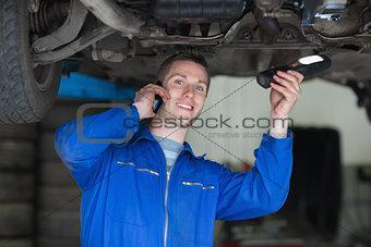 Car Mechanic using cell phone
