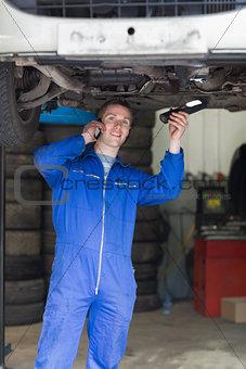 Auto mechanic using cell phone