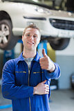 Happy male mechanic gesturing thumbs up