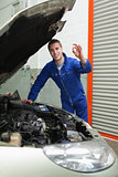 Mechanic by car making ok sign