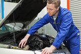 Mechanic closing the lid of windshield washer tank
