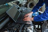 Auto mechanic using laptop