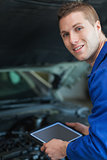 Mechanic holding digital tablet