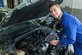 Auto mechanic by car with tablet pc