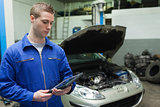 Mechanic looking at tablet pc