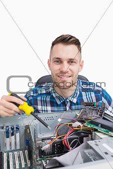 Portrait of computer engineer repairing cpu