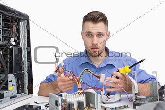 Portrait of young computer engineer working on cpu parts