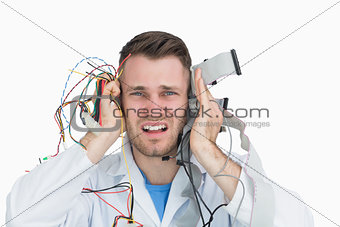 Young it professional yelling with cables in hands