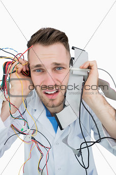 Closeup portrait of it professional yelling with cables in hands