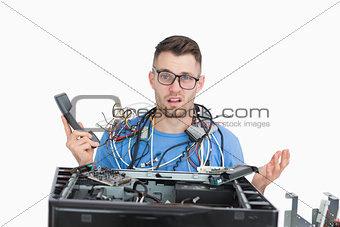 Confused it professional with cables and phone in front of open cpu